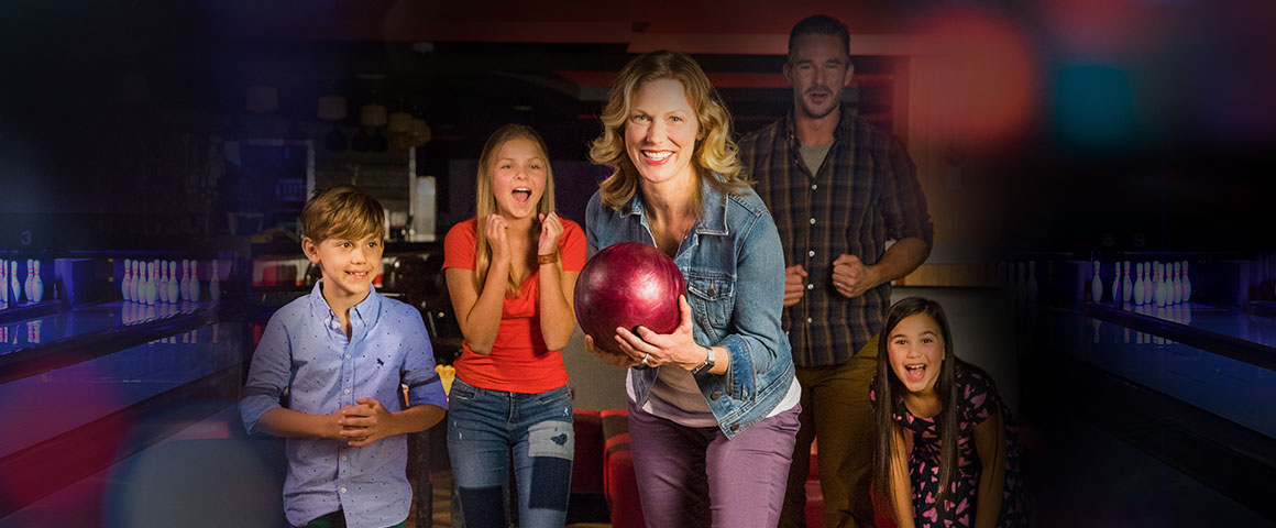 family getting ready to bowl