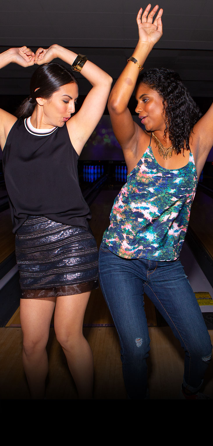 Two girls dancing on the lanes