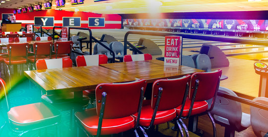bowling lanes and dining tables