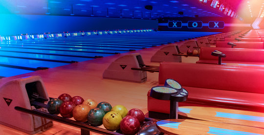 Bowling lanes and red plush couches