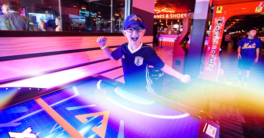 Boy having fun in an arcade