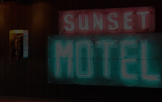 sunset motel in neon lighting