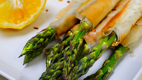 Filo wrapped asparagus on a plate