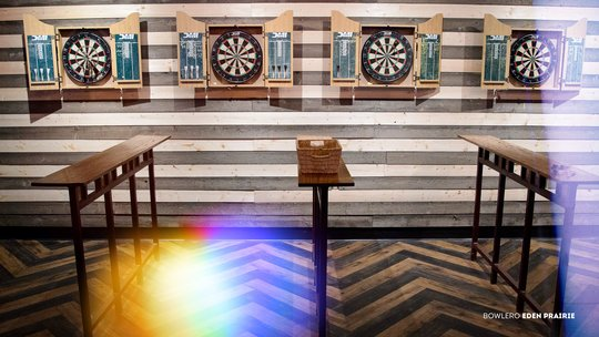 dart boards on a striped wall