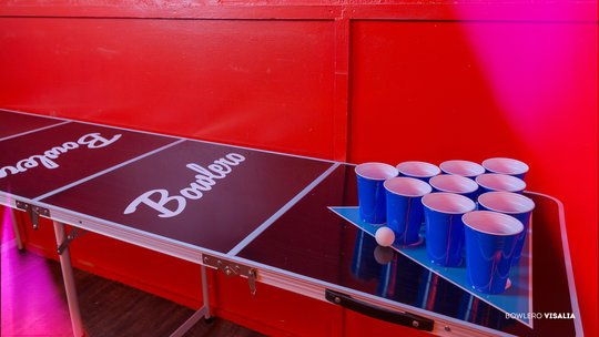 beer pong table with red wall