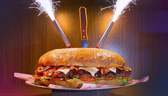 six pound Behemoth burger with sparklers