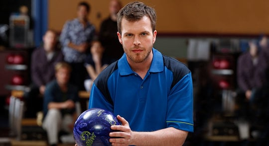 Male league bowler holding a bowling ball