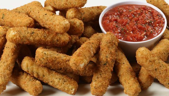 Mozzarella sticks with a bowl of marinara sauce