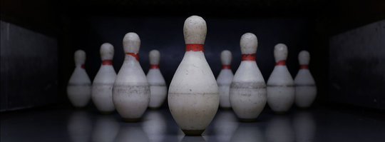 duckpin bowling pins set up in a triangle