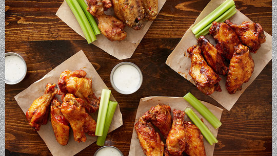 groups of wings on a table with ranch