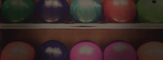 two rows of colorful bowling balls