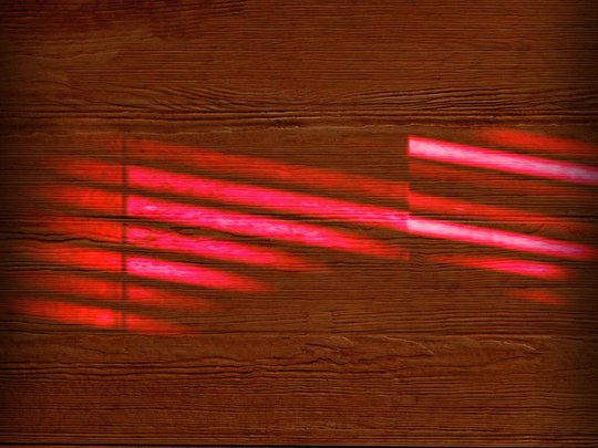 wood background with red streaks