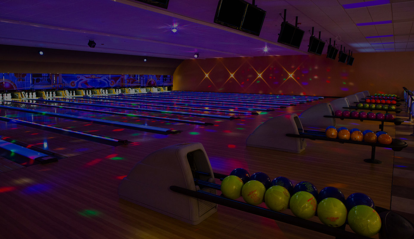 Dark photograph of a bowling alley