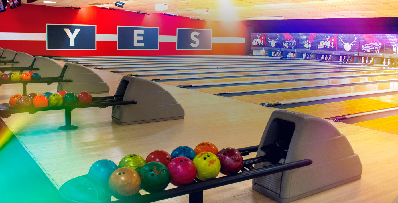 bowling lanes and the word Yes on the wall