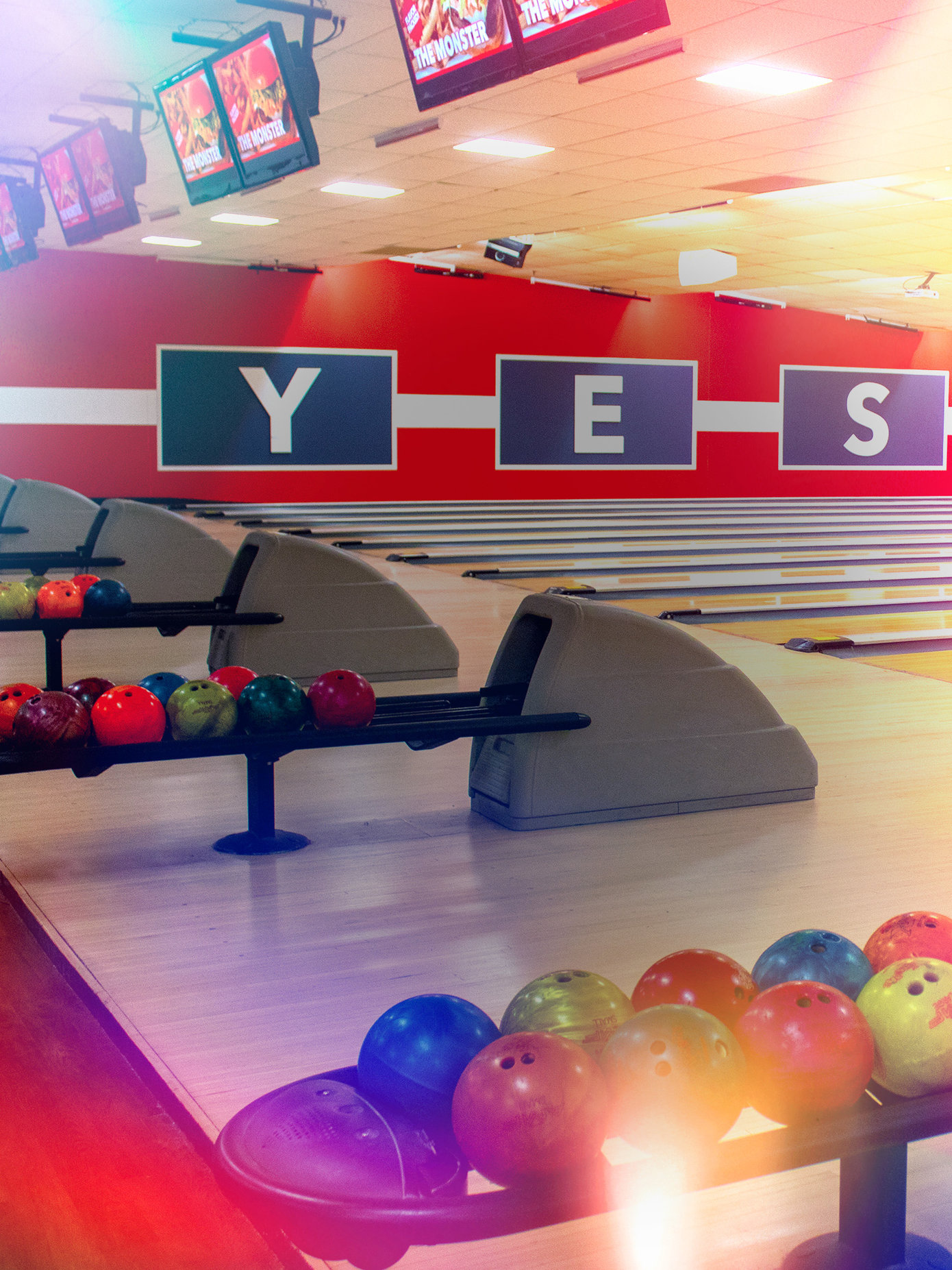 bowling lanes with the word Yes on the wall