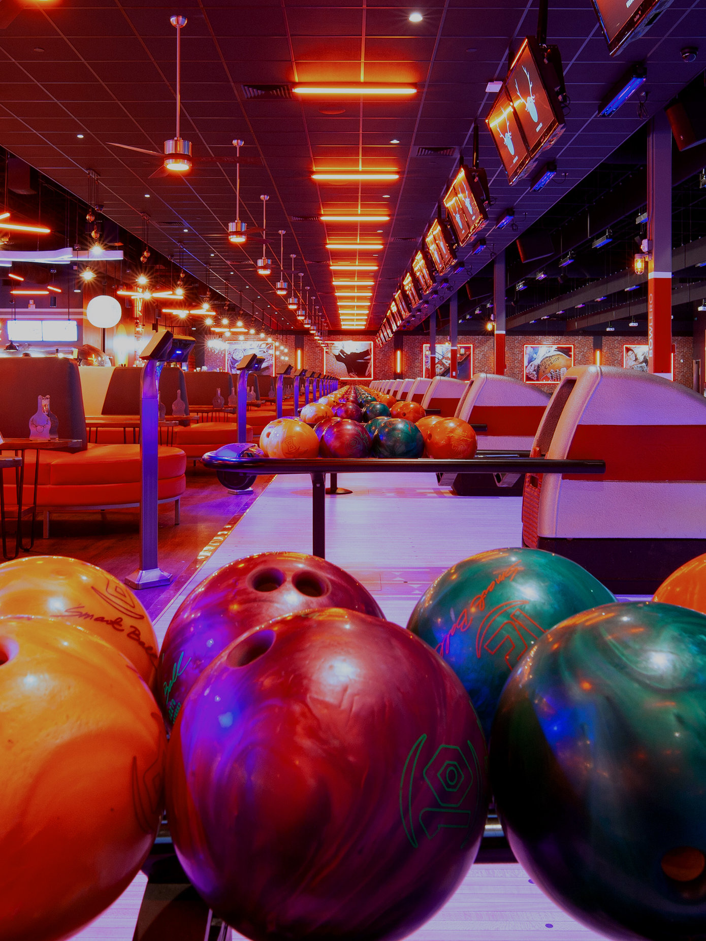 bowling balls with lanes in background