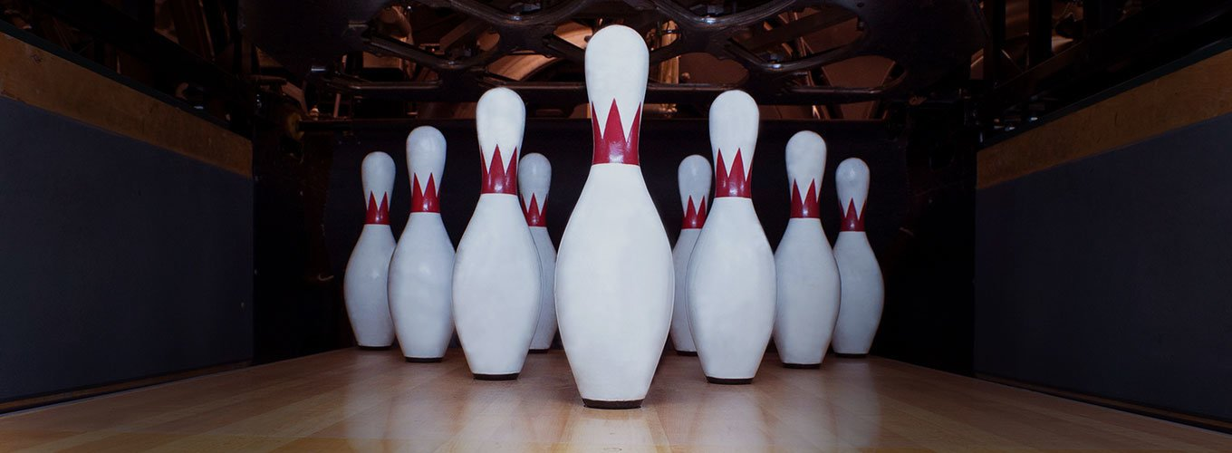 bowling pins arranged in a triangle