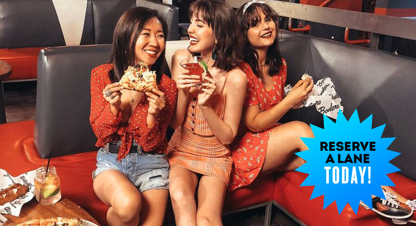 three girls laughing with food