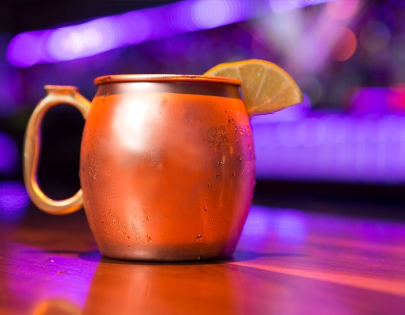 Moscow mule with a lemon wedge in it