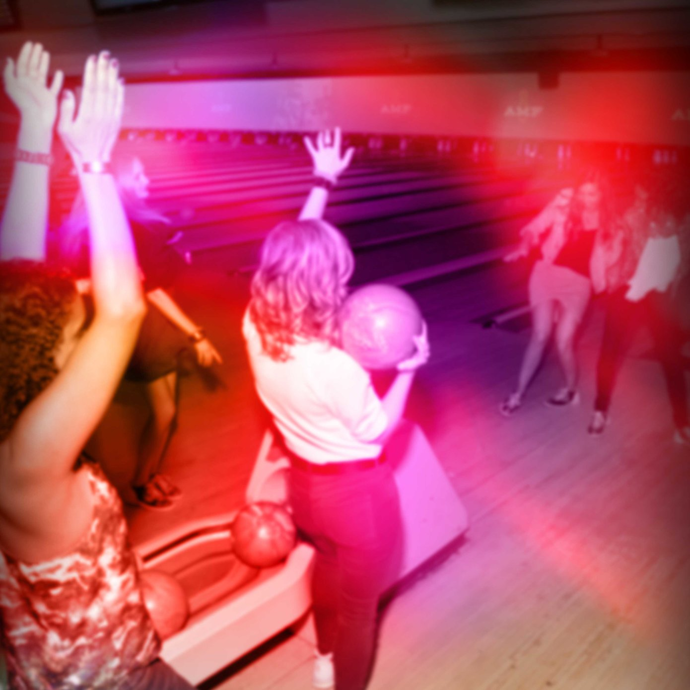 Girls cheering and dancing on lanes