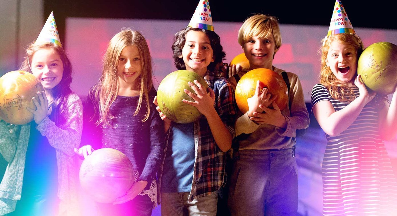 Kids In Birthday Hats Holding Bowling Balls