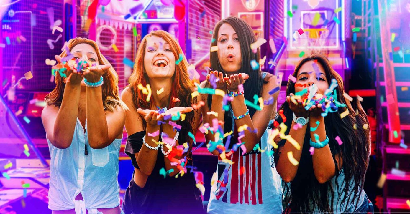 Teens in arcade throwing confetti