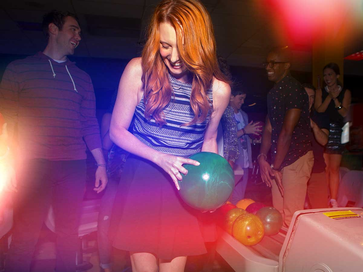 Girl Holding Bowling Ball